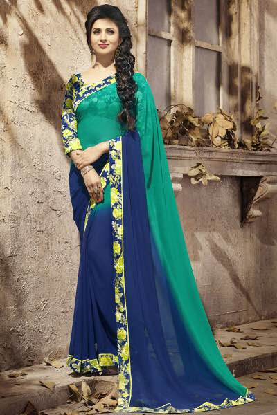 DIVYANKA TRIPATHI BLUE AND TURQOISE FLORAL BORDER FANCY SAREE   Geogette Casual Sarees   We are leading manufacturer of Geogette Casual Sarees in Surat, Gujarat.   We are leading supplier of Geogette Casual Sarees in Vadodara, Gujarat.   We are leading supplier of Geogette Casual Sarees in Ahmedabad, Gujarat.
