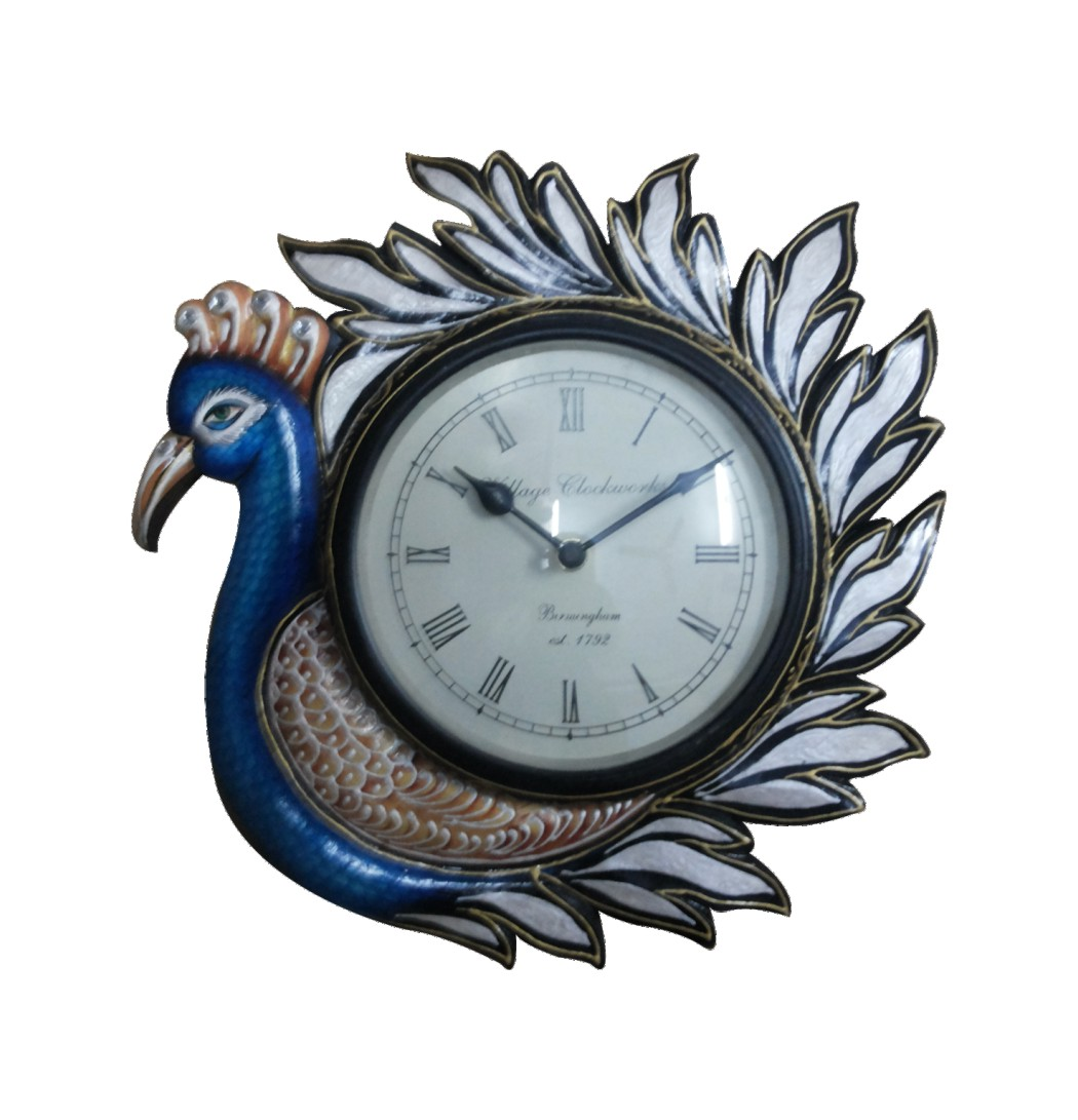 PEACOCK WOODEN WALL CLOCKS or MOOR DIWAR GHADI made by the hands of the expert craftsman of Jaipur with the fineness Quality Carving on peacock Design. Peacock Wooden Wall Clocks or Moor Diwar Ghadi made of wood in shape of Peacock with quality Carving and hand painted art work for Peacock Wall Clocks which is gives the Antique and decorative look for the home Decor as well as for gift purpose. We