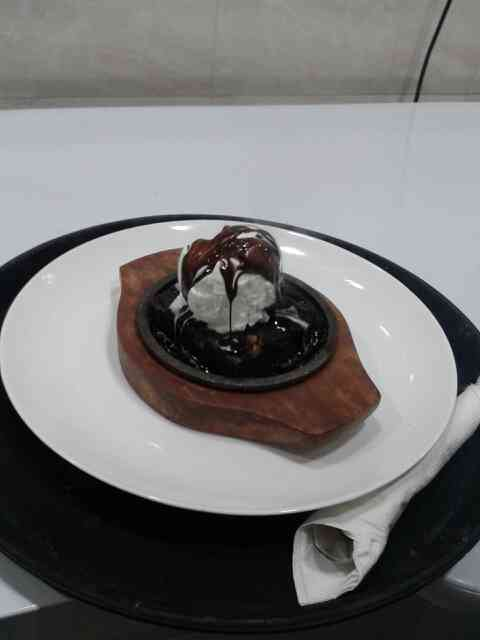 enjoy hot chocolate sauce with brownie & ice cream yummy test of dessert at cafe @ mj in manjalpur vadodara . 9712423490