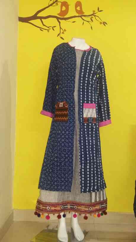 Gown n Jacket.... All in cotton with vibrant coloured laces ....Front open Indigo upper Jacket with pockets... Inner gown is of striped cotton, Ikkat, or tie n dye style stripes... It's a smart and trendy dress...