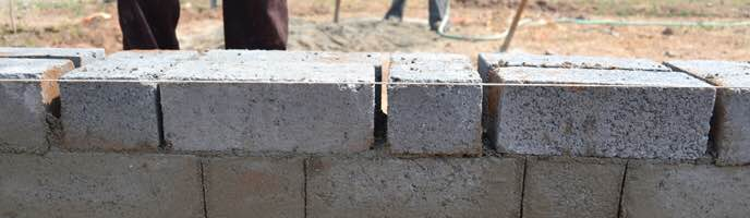 Standard Bricks  Policies of the government to enforce environmental constrains on the traditional clay brick making, there is a gradual reduction in the supply of traditional bricks. Realizing this gap between supply and demand of standard bricks for construction in the market, ABC have introduced standard bricks into its product portfolio. Soil erosion issue will also be tackled in the longer run by avoiding the standard clay bricks.  Standard brick is the most common product for all masonry requirements. It is also used as paver blocks at several places.  We at Advice Built Care Pvt. Ltd. are in a position to offer blocks conforming to the size of standard bricks. These bricks can be used for paving solutions as well.  Standard bricks are available in the size of  225mm X 100mm X 80mm. Bricks manufactured are more durable and provide a better finish.   We are located at Vadodara, Gujarat.   We can supply Standard Bricks at Ahmedabad, Gujarat.   We also supply Standard Bricks at Suarat, Gujarat.