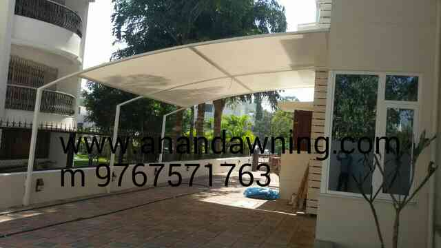 wall mounted tensile car parking shade  good look and best price. manufacturer , supply and installation.