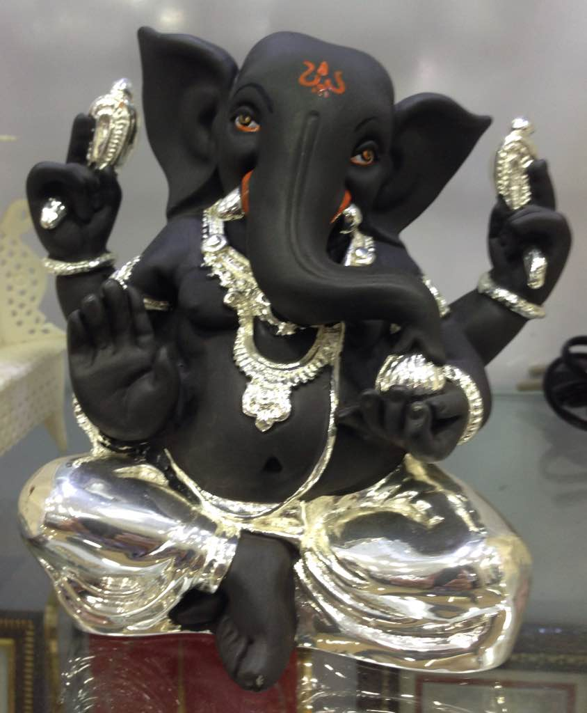 Lord Ganesha Idol made with terracotta and plated with sterling silver to give a very sophisticated feel to it. These idols come in a variety of shapes, sizes, colours and concepts. Lord Ganesha is known to bestow luck and prosperity, so it makes an ideal choice for gifting your near and dear ones.
