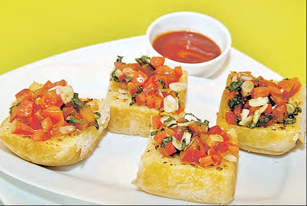 Combine a delicious Bruschetta with a Cappuccino or Iced Tea! - by ANAVILA - Indie Bistro & Coffee Shop, Hyderabad