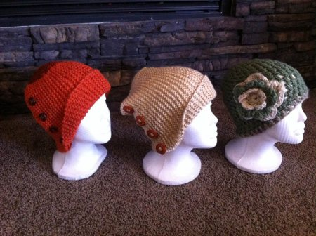 Orange hat size adult small..$20 Beige hat size adult large..$20 Green with flower hat size adult small..$15  - by Lynnsknits, Greater Sudbury Division