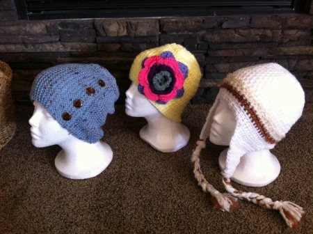 Kids hats size medium.. Blue ..$20 Yellow with flower..$15 White.. $20 - by Lynnsknits, Greater Sudbury Division