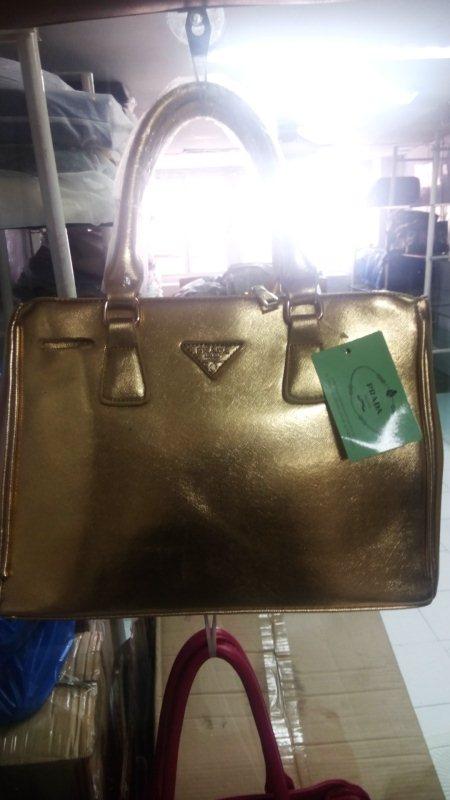 Exclusive Prada Handbag with Gold Colour.... - by S R Fashion, Ahmedabad