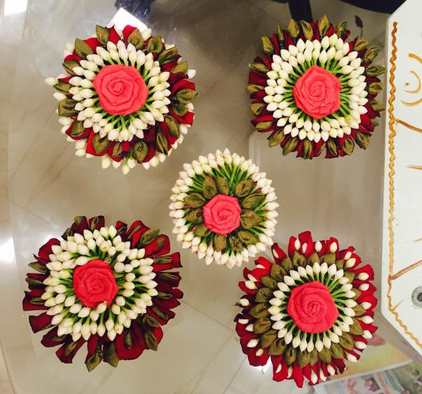 hours of labour has turned flowers into these adorable clips ... handy and attractive for gifting the guests..  available at samprathaaya  - by Samprathaaya , Dindigul
