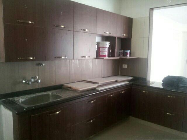 Modular kitchen - by Puran Interiors, Bengaluru