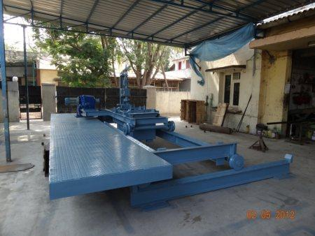 BOTTOM POURING MACHINE  * With two axes drive upto a maximum capacity of 2 tons  * Used for foundry  - by SICCO ENGINEERING WORKS, Chennai
