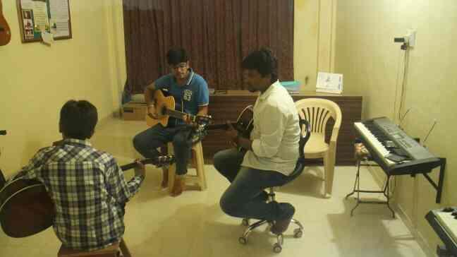 Guitar lessons - by Mandra Academy of Music & Music Technology, Gandhinagar