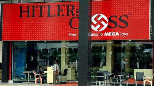 3. Cross Cafe, Mumbai - For The Nazi Groupies  Cross Cafe, formerly known as Hitler's' Cross , is an Adolf Hitler-themed restaurant at Kharghar in Navi Mumbai. The restaurant's interior was decorated in red, white and black - the colours of - by Rodrigues Tour and Travels, PUTTUR