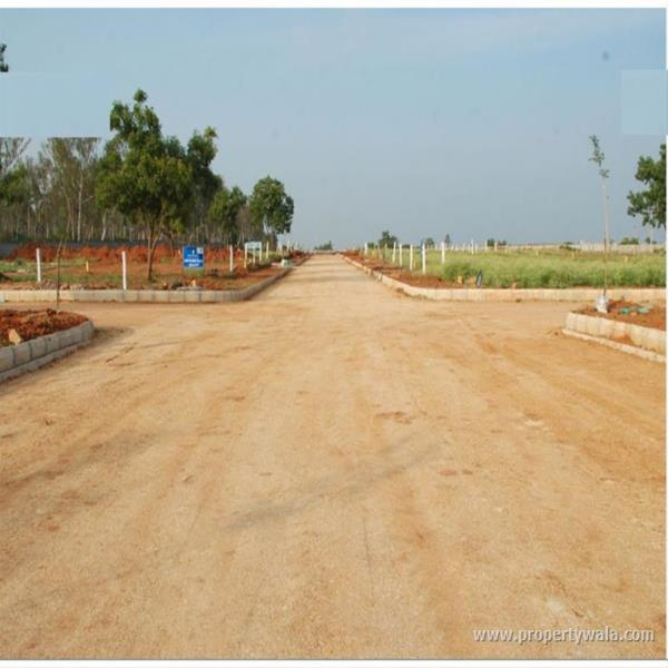 PROJECT HIGHLIGHTS: VUDA Approved Layout,  Plots Sizes 90, 167, 200 and 240,  Open Drainage and Electricity,  Gated community with 6 Feet height compound wall,  ALL 40' Feet B.T. Roads,  Children's play parks,  Designer Landscape Avenue Pl - by Lakshmi Nivas, Visakhapatnam
