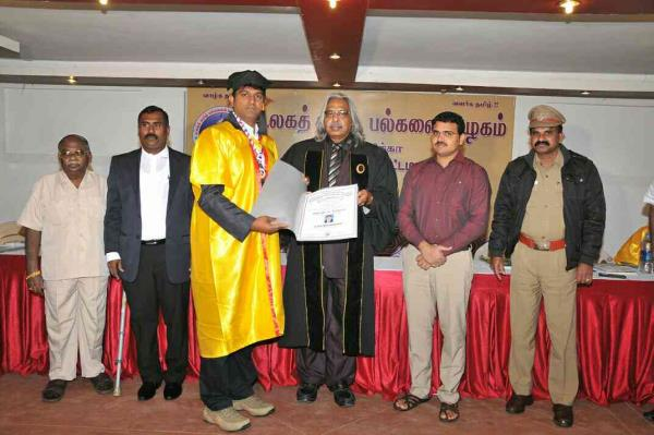 Dr.R.Balamuralikrishnan receiving Honorary Doctorate Award from International Tamil University, USA. For his commendable Physiotherapy Skills and Social Service.  - by OCHRE Fitness & Physio Clinic, Sivakasi