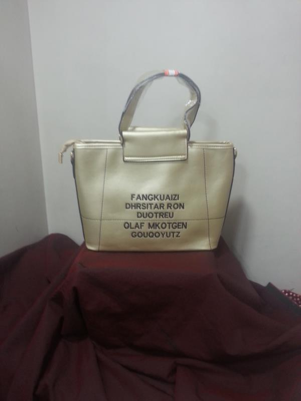 ladies golden hand bag with sling  single compartment   - by Mumbai Ladies Bags, Mumbai