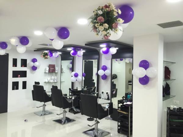 Decoration done with purple n white theme for naturals opening at R.M. colony, dgl - by Samprathaaya , Dindigul