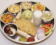 Punjabi Food; Punjabi cuisine : Chole, Paratha/Aloo Paratha, Halwa poori, Bhatoora, Falooda, Makhni doodh, Amritsari Lassi, Masala chai, Tea, Amritsari Kulchas, Phainis, Dahi vada, Dahi, Khoa, Paya, Aloo Paratha, chaas, tava chapati, Bhatoo - by Restaurant Desert Bite Jaisalmer, Jaisalmer