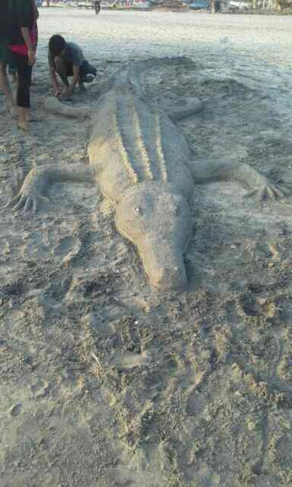 kovalam beach view with sand art - by Travel Khans, Madurai