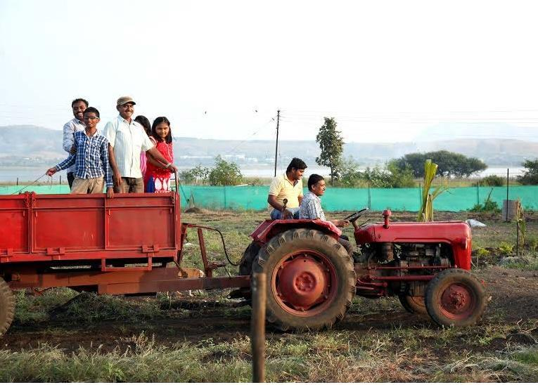 Tractor Riding near Gangapur Dam - by Nisarg Raja Agro Tourism, Nashik