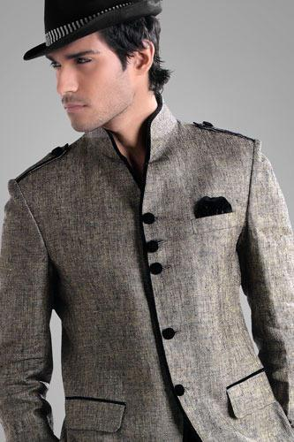 Dashing coral color jodhpuri coat planed on jute designed with multi pockets and metal buttons is to make a mark in the world of style. Comes with matching trouser. Be in fashion anywhere by wearing this dazzling outfit. - by Ajmer Tailor Jai Bhole Ki Dukan  (Suit Specialist), Ajmer