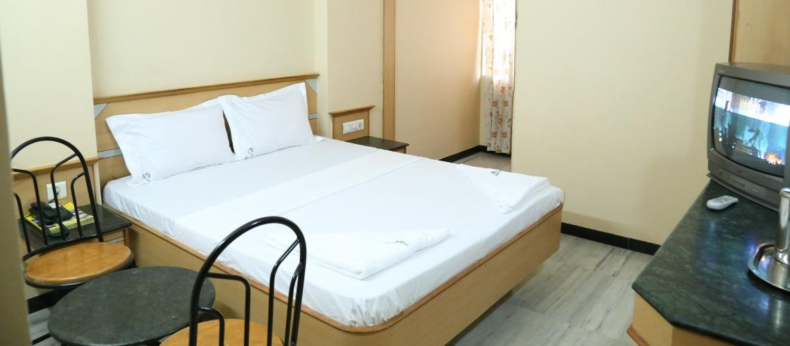 Hotel ESS Parasdise In Coimbatore                                                  Deluxe Double Occupancy Room with amenities and services are best in class. Book Online Now! A/C .  Hotels In Coimbatore Hotels In Gandhipuram Budget Hotels  - by Hotel ESS Paradise, Coimbatore