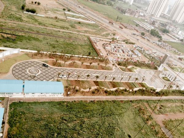 Aerial view of M3m Golf estate main entrance plaza. Call us now for best deals in #m3m #golfestate - by Kalra Realtors, Gurgaon