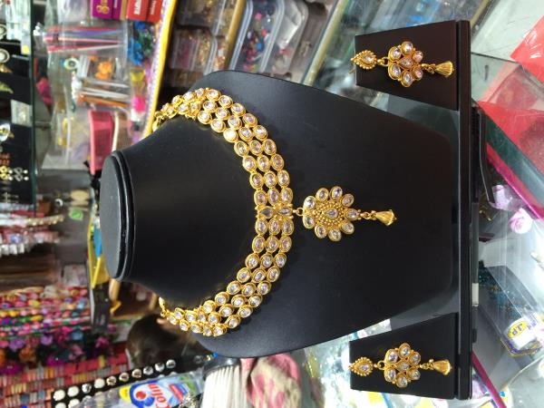 ready for the function. thats cool get the latest jewellery for your dress - by Arora Store, Delhi