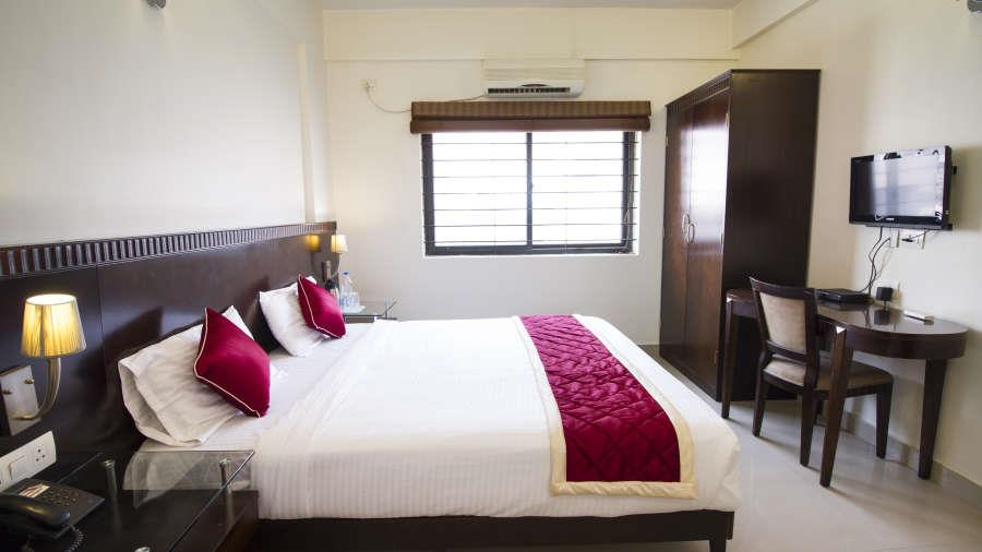 Hotel Amshi International Inn, Gandhinagar, Bangalore Hotel Amshi International Inn offers luxuriously furnished rooms and suites that are fully equipped with modern amenities.  he suite is the largest room at the hotel. Equipped with all m - by Cozy Shelter, Bangalore