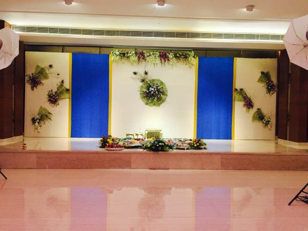 """""""Dhoti ceremony """" - A typical Telugu function done for Dr. Senthil & Dr. Sujatha son  Master Prathyush ..  The decor was done with elegant orchids and highlighted with peacock feathers .. extravagant banaras was used to match the color sche - by Samprathaaya , Dindigul"""