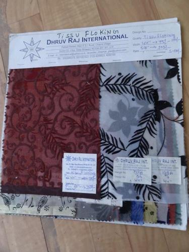 Nylon Tissue Flocked Fabric Manufacturer   Our offered fancy fabric is broadly appraised by our clients owing to its eye-catching colors, alluring design and optimum softness.   Features:  Fade resistance Trendy look Softness  - by Dhruv Raj International, Noida