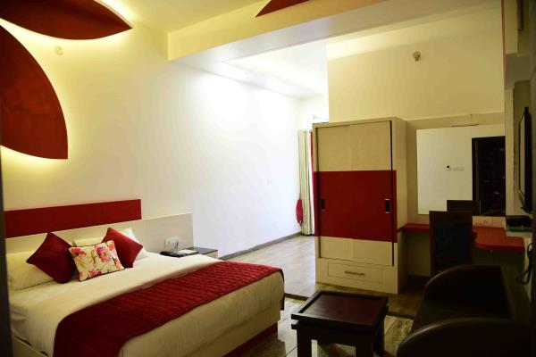 room well furnish with wood and granite and colour combination of red and white ...................mixture of peace and love  - by Hotel Kangra Rodeway Inn, Kangra