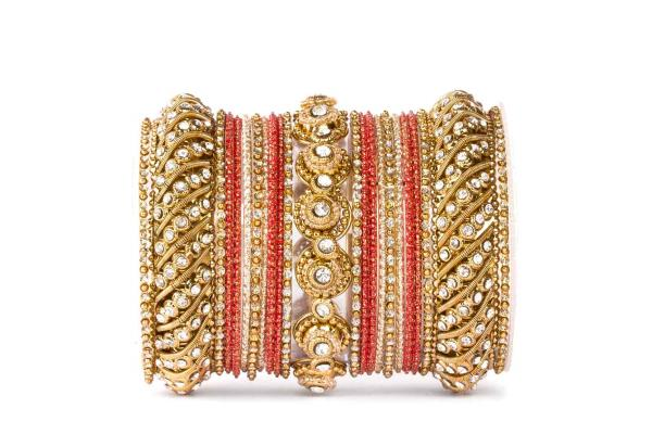 Buy traditional red colored bangles for wedding by Leshya online. At Rs.599 wear bangles which are rich with golden texture and suitable for all traditional occasions.  This design by Leshya is complimentary to sarees and lehengas with gold - by www.leshya.com, Mewat