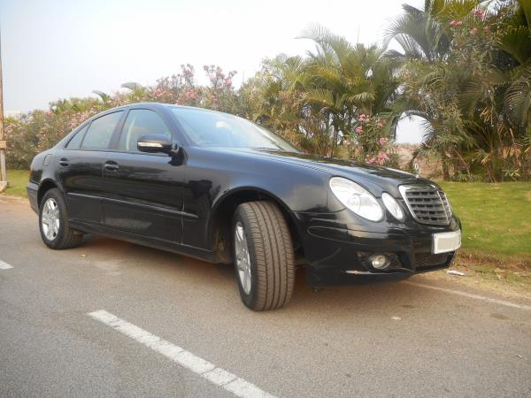MERCEDES E-200 Kompressor  2006- March Black Colour  Single Owner  well Maintained 26000kms  Brand New Tyres This is the Best Preowned car in Petrol - by Honda Auto Terrace, Hyderabad