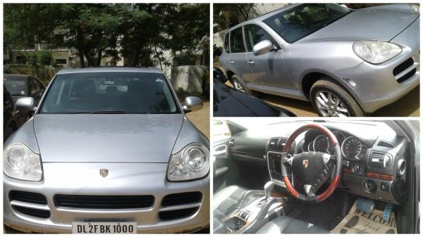 Well maintained, Porshe Cayenne - 2004 model, silver color, 95 Km driven with sunroof.  Best used car dealers in gurgaon - by Autoknox (call us at 9873330036), Gurgaon