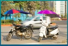 Two Wheeler Umbrella  is useful for all your bikes and scooters - by S S Marketing, Secunderabad