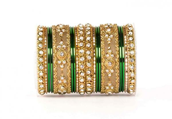 This bangle set by Leshya contains 18 pieces. It is a tradtional design for both hands. Bangles are re-arrangeable according to the wearer. The design is highlighted by the central piece which intricate and wonderfully blends with golden em - by www.leshya.com, Mewat
