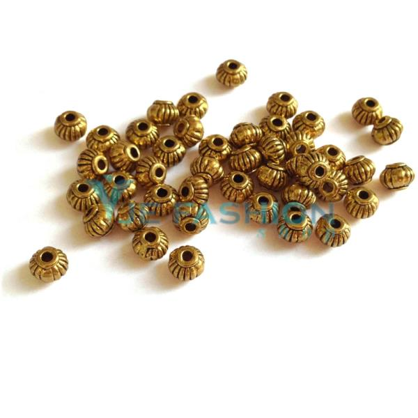 Back in stock:  http://www.jefashionshop.com/jewel-supplies-bead-components/bead-spacers/antique-gold-spacers/antique-gold-round-spacers-5x4mm-jefs-spa-ag-00012 - by JE Fashion Shop, Coimbatore