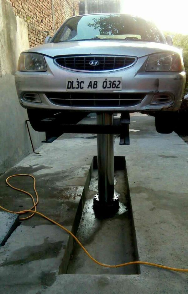 Car washing lift manufacturer - by Amfos International, Delhi