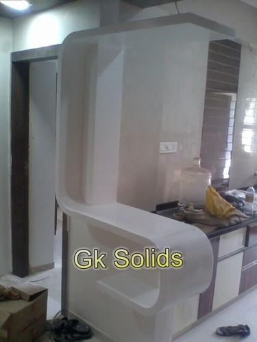 "Corian Solid Surfaces Supported by a team of skilled and creative professionals, we have been able to offer an enticing assortment ofAcrylic Solid Surface (Corian). Under the supervision of our professionals, the range is aesthetically manu - by ""G. K. Solids"", Ahmedabad"