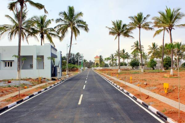 Plots near E City, with luxury amenities. BMRDA approved, with 'A' Khatha, Near 300 ft proposed Ring Road.  www.jrhousing.com  - by JR Housing Developers Pvt. Ltd., Bangalore