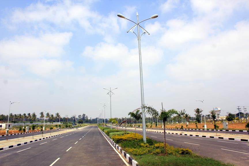 The Greenest Township in Bangalore  Plots & Villas near E-City, with luxury amenities, Club House etc.  BMRDA Approved plots with A Khatha.  www.jrhousing.com - by JR Housing Developers Pvt. Ltd., Bangalore