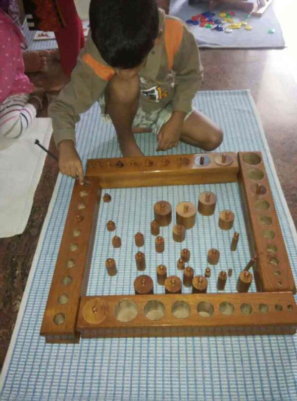 knowing the dimensions with cylinder blocks - by Vistas Montessori, Bangalore