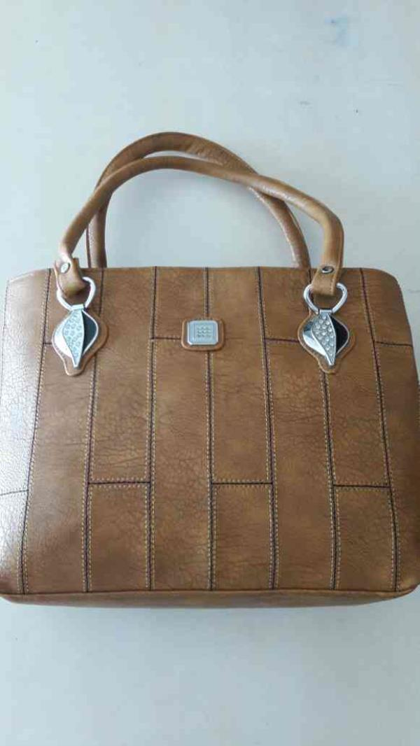 All types of Ladies bags manufacturers and traders in ahmedabad .This is our bag of size 12×18 ladies purse - by Raj Bag House, Ahmedabad