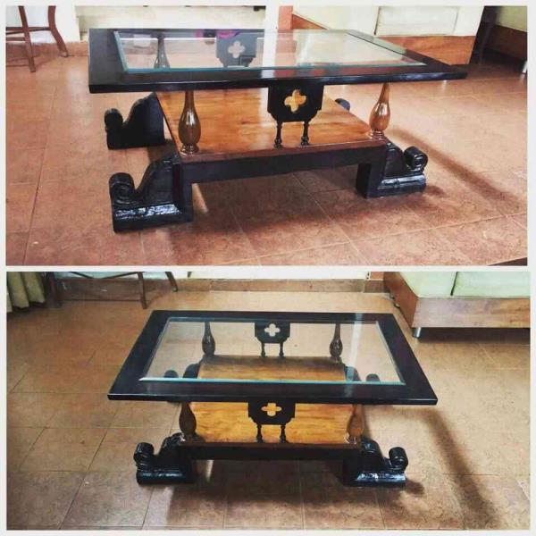 One pillar capital, four broken chair legs, salvaged parts from a railing baluster and a window frame come together to serve as a centre table. #revivedesigns #revive #reuse #upcycle #sustainablefurniture #recylcedwood #woodworking #table # - by Revive Designs, Bengaluru