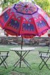 HAND CRAFTED GARDEN UMBRELLA Color Red Base colour with Blue colour thread embroidery of elephant Company Craft Elephant Item Model Number Primary material Cotton Capacity King - by Craft Elephant, Ahmedabad