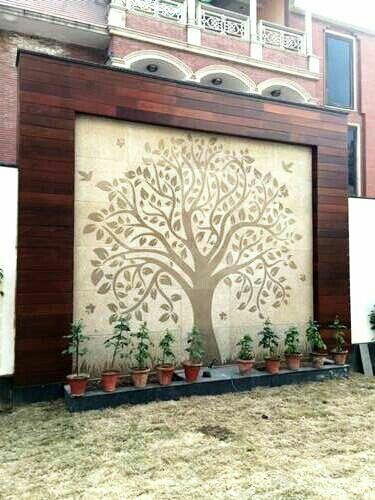 hand made mural of tree of life on sandstone mossy green  framed with Brazilian  ipe to create a stunning feature wall in your garden  - by Designer Landscapes, New Delhi