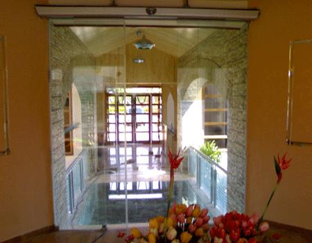 we do Automatic Glass Doors for your entrance. this Sensor Automatic doors adds aesthetic to your door way - by Doors & Beyond, Chennai