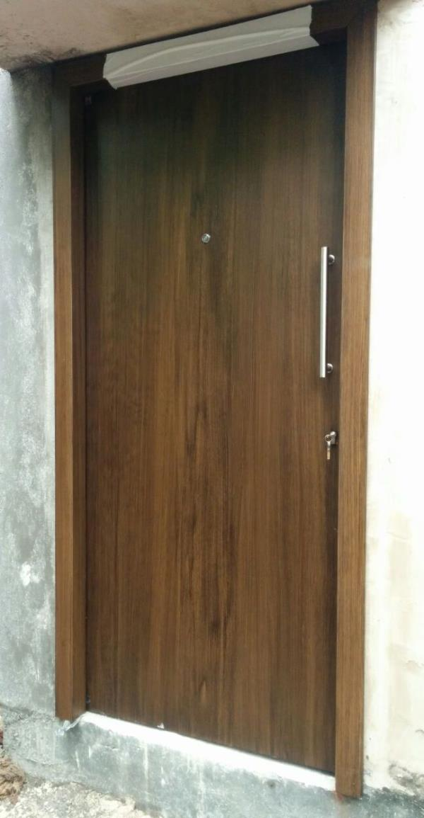 We give best in class SHakti Hormann Steel Door for your entrance in wood finish.this gives rich look, safety and longer life than normal wooden doors - by Doors & Beyond, Chennai