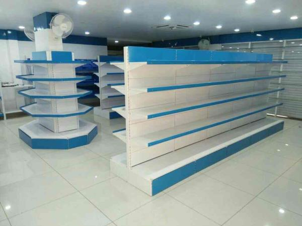 Super Market Racks would serve the purpose only if the displayed items are exhibited properly. Our Super Market Racks are available in different makes and types. One such variety is our vertical display different items are displayed systema - by KRISHNA INTERIO, Ahmedabad