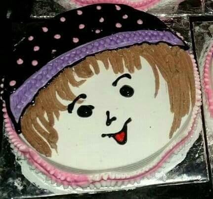 face drawing on cake - by Marigold , Pune